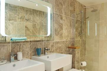 Twin basins and an LED-lit mirror in the shower-room.