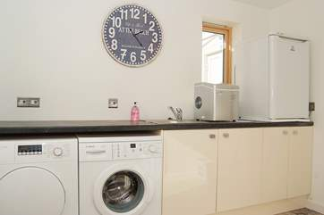 The useful utility-room has a washing machine, tumble-drier, second fridge and an ice maker.