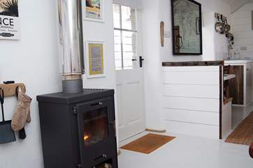 The living accommodation is set around the wood-burner.
