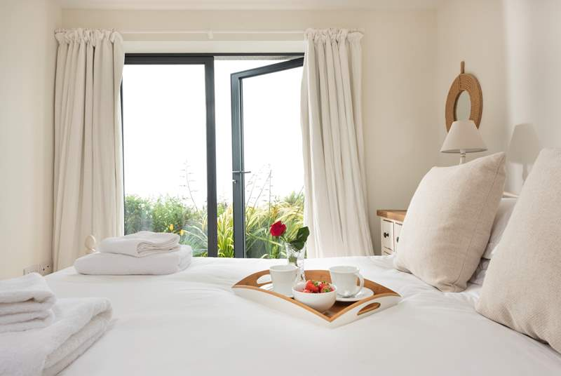 The master bedroom at Windjammer- wake up and watch the boats bob by.