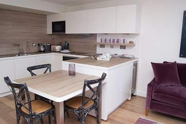 The kitchen and dining-area.
