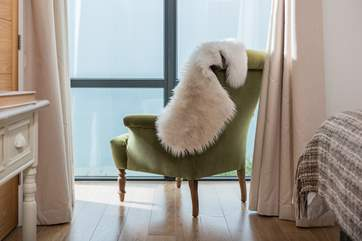 The squidgy armchair perfectly positioned in the master bedroom to curl up and watch the world sail by.