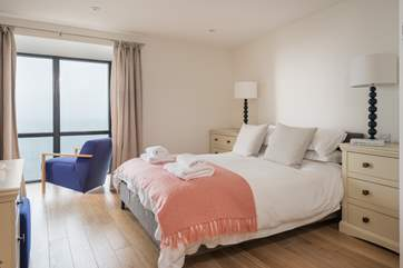 The soft pastel colours compliment the master bedroom perfectly.