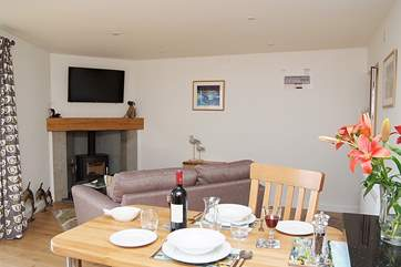 The open plan living-room in Rame includes a warming wood-burner.