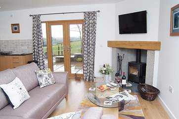 The lovely sitting-room in Tregantle, which has a wood-burner for those cooler evenings.