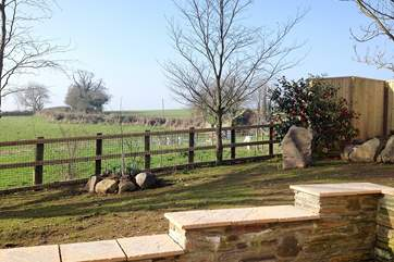 The patio at the rear of Tregantle has views over the countryside.