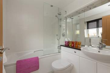 This is the family bathroom, with bath and fitted shower.