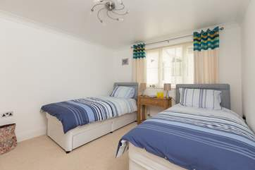 This is the twin bedroom. The three-foot beds make it ideal for adults as well as for children.
