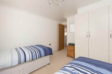 Another view of the twin bedroom. This room also has plenty of storage space.