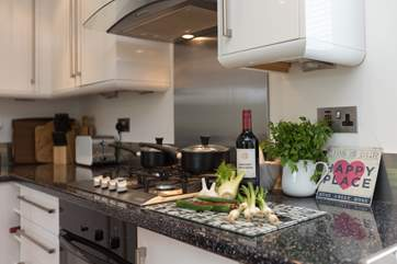 The contemporary kitchen has plenty of storage space.