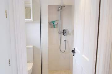 The wet-room is next to the open plan living-room.