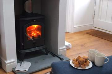 On cooler days, you can keep toasty around the cosy wood-burner with your cup of cocoa.
