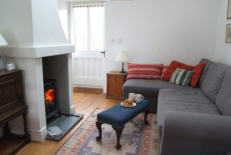 The front door opens into the open plan living-room with comfy L-shaped sofa.
