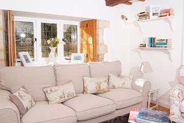 A deep comfy sofa and armchairs make this a lovely room to relax in.