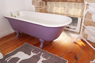 There is a deep roll-top bath to have a soak in.