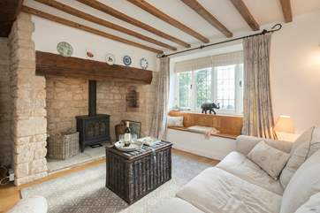 The characterful living room has a wood-burner effect gas stove for extra warmth.