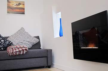 A modern fire makes a great focal point (under-floor heating is also provided, so you will be cosy all year round).