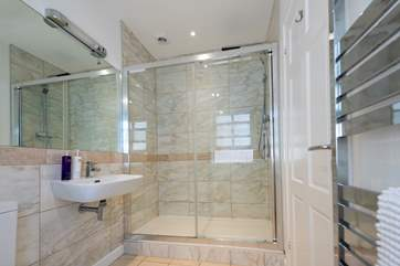 The shower room boasts a huge shower and modern fittings.