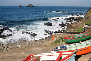 Colourful fishing boats in the cove at Cape Cornwall.