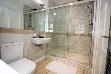 The shower-room boasts a huge shower and modern fittings.