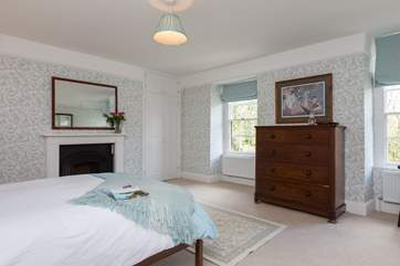 This is the exceptionally spacious master bedroom with dual-aspect windows overlooking the river Barle.