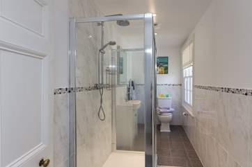There are two bathrooms - one with a large shower and the other with a bath and shower over. Both are a really good size.