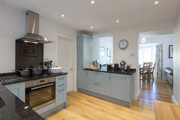 A super contemporary kitchen makes use of some original features to link into the rest of the living space.