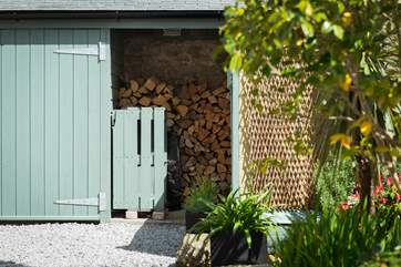 The log-store to the rear of the cottage, your first basket by the fire is complimentary.