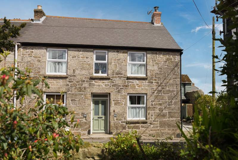 This pretty cottage 'Old Walls Cottage' has a Cornish name on the front Fosow Koth.