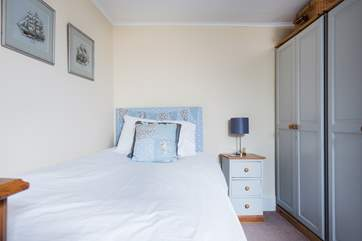 This pretty single bedroom has plenty of storage.