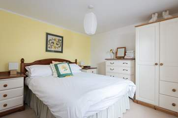 The pretty double bedroom, one guest said in the visitor book 'comfy beds and lovely decor, a great find.'