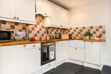 The delightful kitchen-area is very well-equipped.