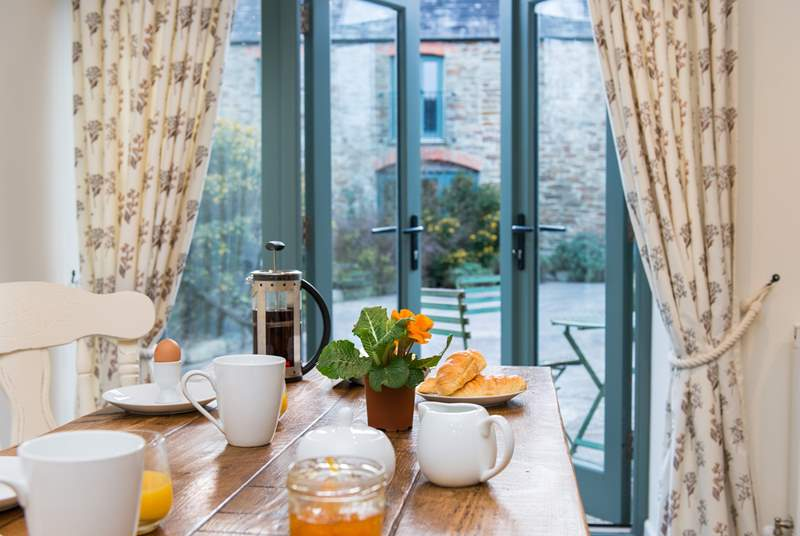 Mealtimes can be enjoyed looking out onto the courtyard.