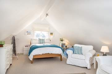 The spacious bedroom lounge area takes up the whole of the first floor - please watch your head with the sloping ceilings