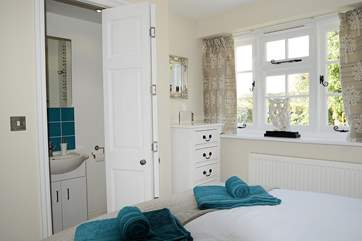 A folding door leads from the bedroom to the shower-room.