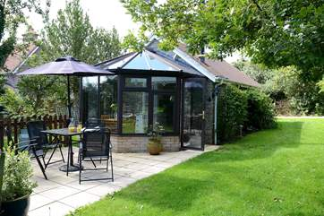 Owl's Nest Cottage is compact with a bright conservatory and pretty patio.