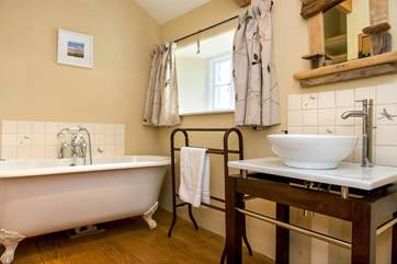 The stylish bathroom on the first floor has a gorgeous claw foot bath.