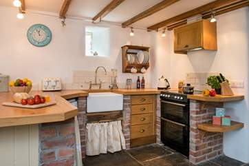The kitchen area has a lovely country feel about it.