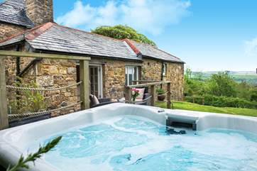 As you relax in the hot tub you can enjoy the wonderful views across the valley.