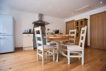 Chunky wooden furniture suits the eco-build cottage.