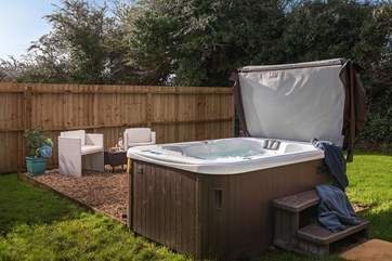 The private hot tub and sitting area, great for chilling out and unwinding.
