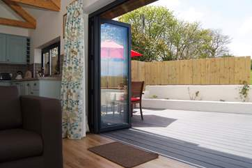 Bi-fold doors open out to the secluded deck.