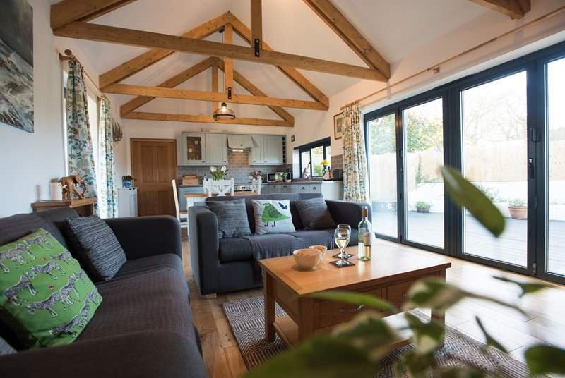 Big bi-fold doors open the room right up to the sheltered deck area.