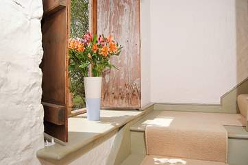 Deep windowsills and the original wooden shutters add to the lovely atmosphere here.