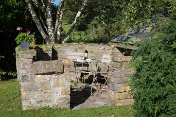 The wonderful old stone pigsty is now a sheltered place for guests to enjoy a glass of wine.