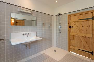 The shower is wet-room style - this is a very spacious room.
