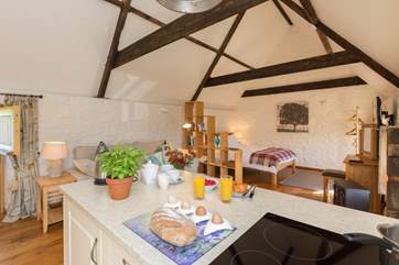 High ceilings and original beams have kept the character of this lovely old building.