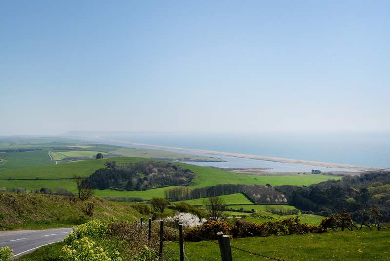 The spectacular coastline with Chesil Beach and the Isle of Portland in the distance. Take a drive along the Jurassic Coast road from Weymouth to Bridport for truly spectacular views in both direction