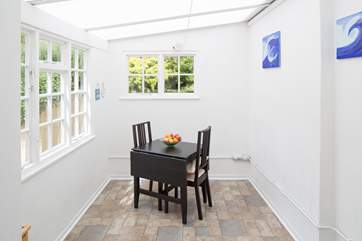 The garden-room provides a really useful extra area with washing machine and tumble-drier.