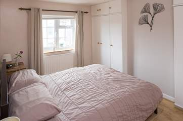 The master bedroom has a 5' bed, fitted wardrobes give a spacious feel, the window looks out to the front of the cottage.